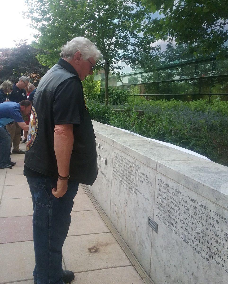 A Vietnam War veteran examines the new memorial in Rockville. PHOTO BY SUZANNE POLLAK