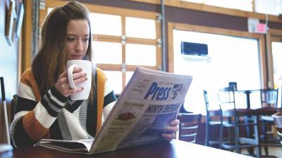 janea reading newspaper