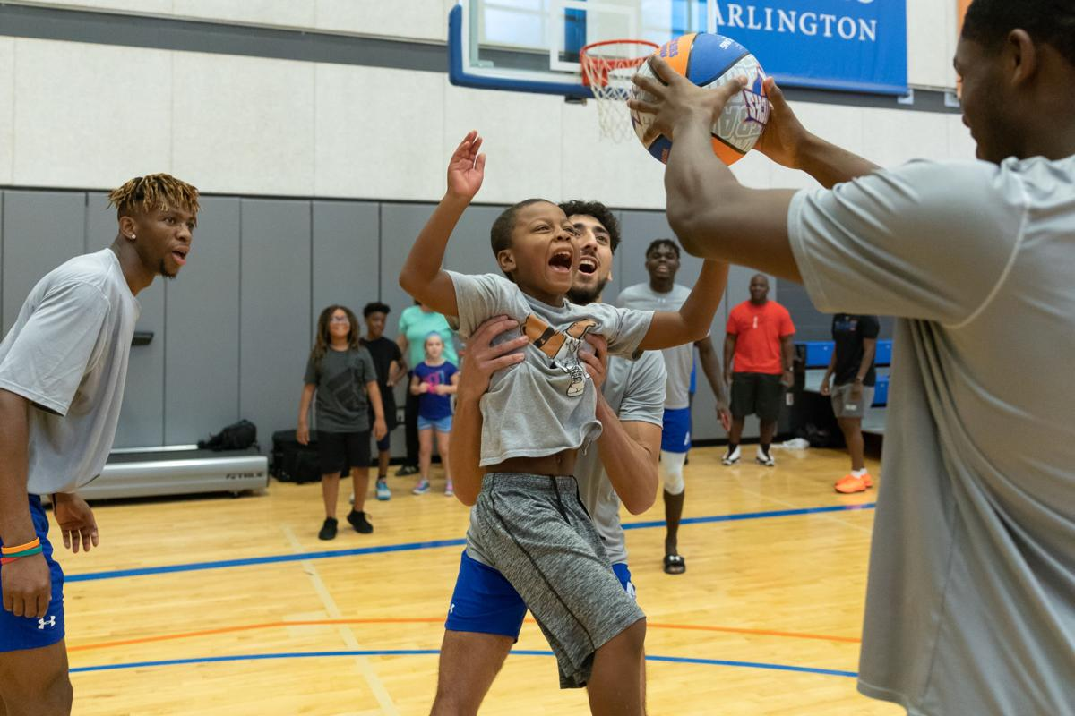 Photos: UTA men's and women's basketball teams host Hoops for Troops basketball camp