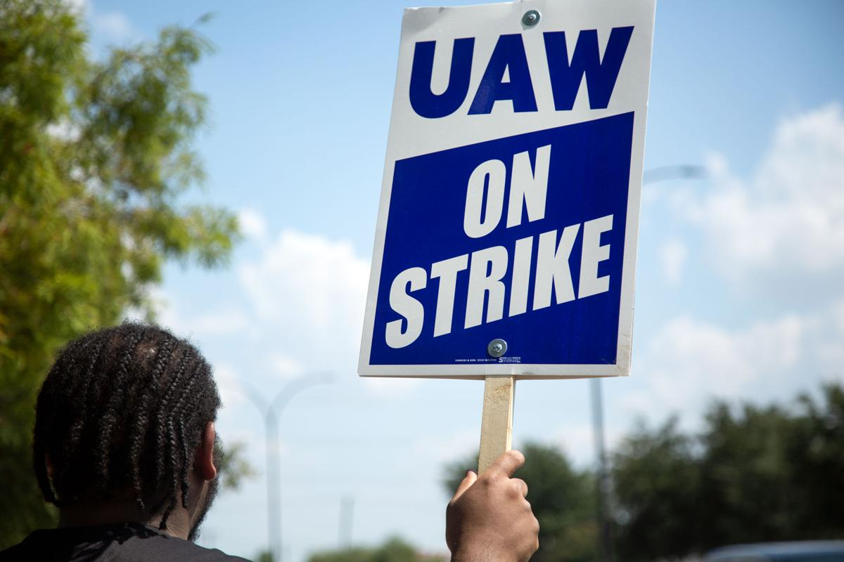 United Automobile Workers strikes outside the Arlington General Motors Assembly Plant