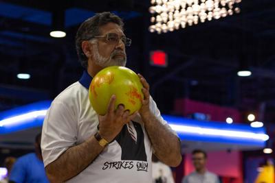 Photos: Karbhari, UTA student split in bowling challenge