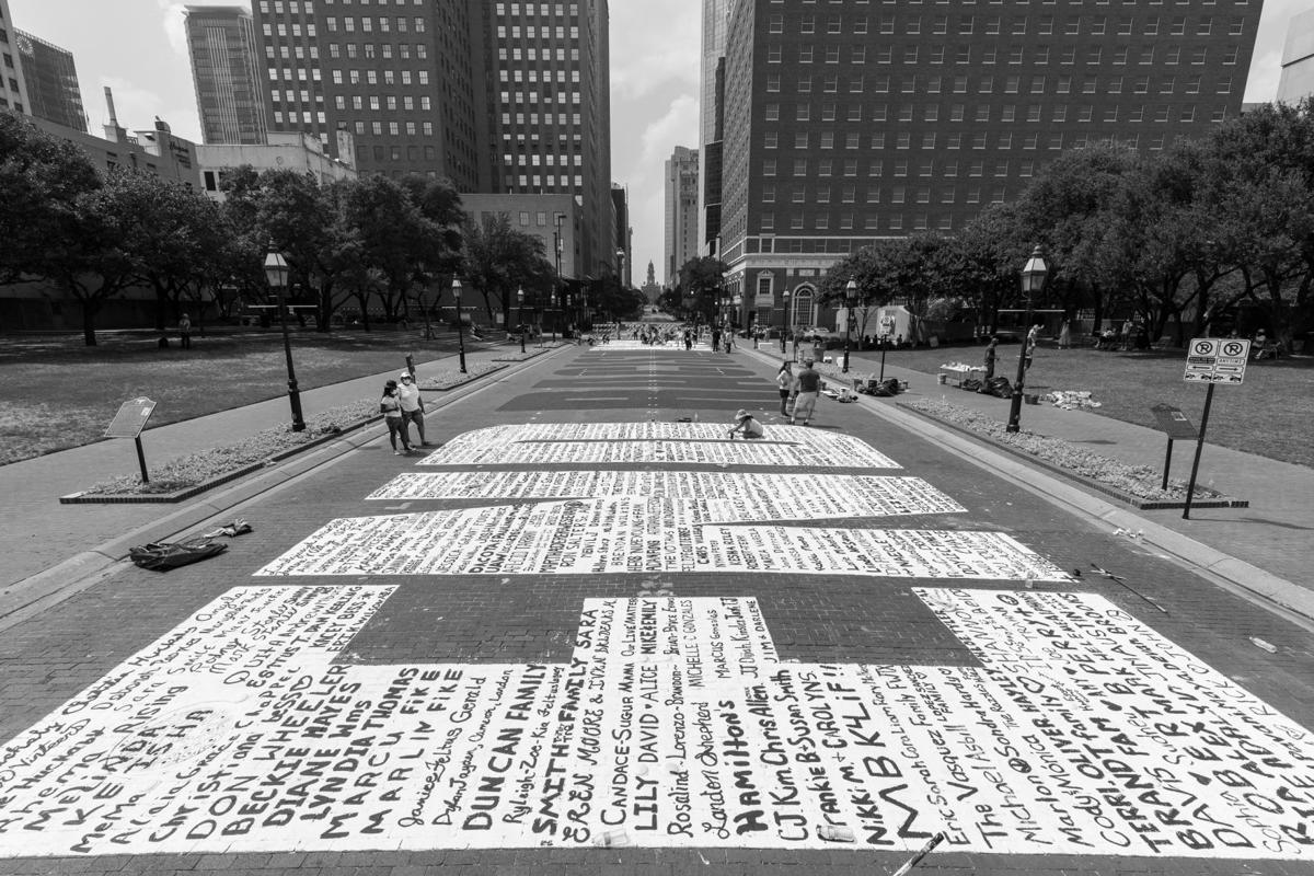 Photos: Volunteers paint 190-foot-wide mural calling to 'End Racism Now' in downtown Fort Worth