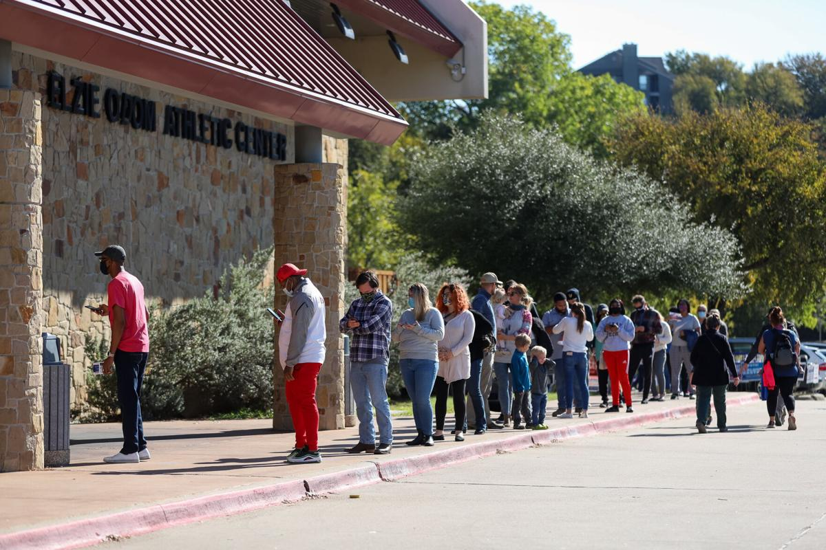 Photos: Metroplex voters brave cold weather at the polls, businesses board windows on Election Day