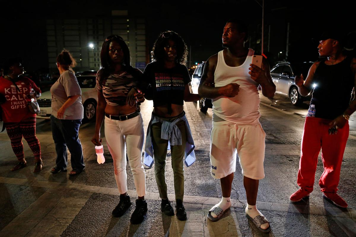 Protesters gather around Frank Crowley Courts Building following Amber Guyger's sentencing