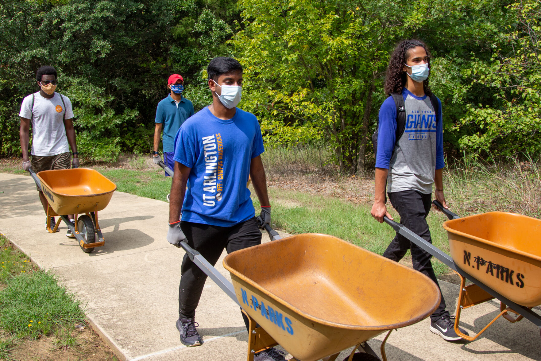 Photos: Volunteers improve trails at O.S. Gray Natural Area for Super Service Saturday