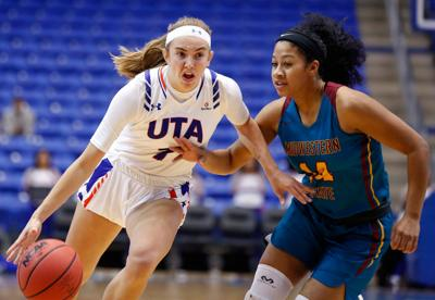 Photos: UTA, Midwestern State University play exhibition match for ovarian cancer awareness