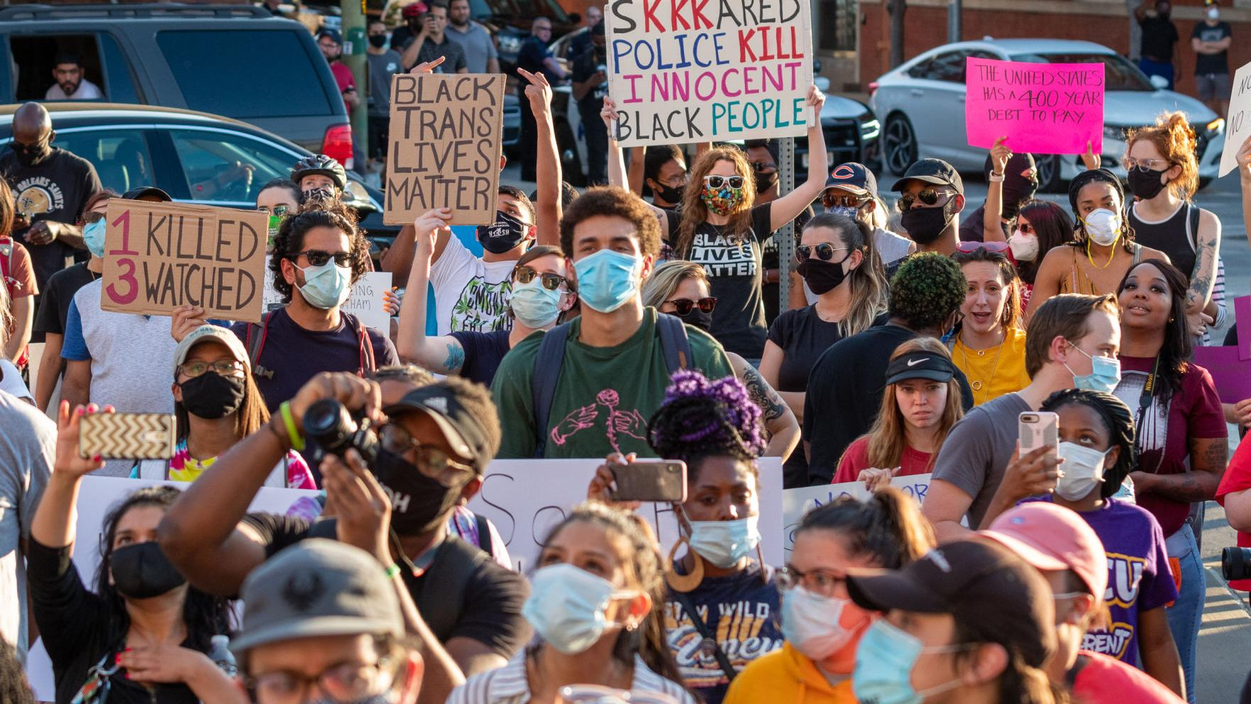Demonstrators rally in downtown Dallas to protest police brutality following George Floyd's death