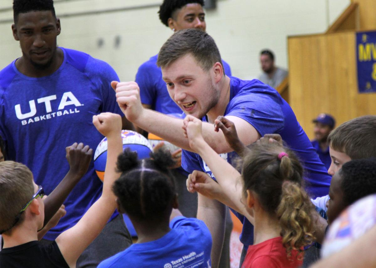 UTA players teach children to play during Hoops for Troops basketball camp