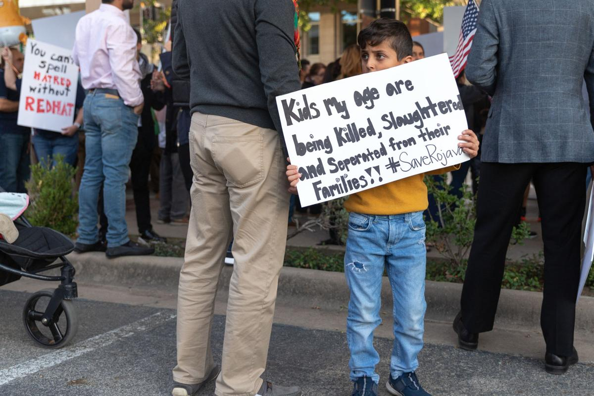 Protesters and Kurdish supporters stand outside President Donald Trump's reelection campaign rally