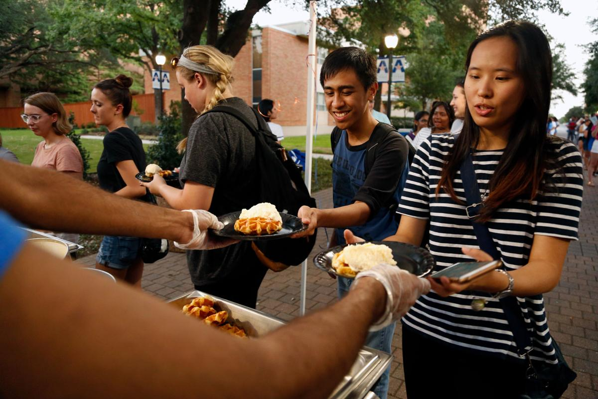 Photos: Students get their fill of waffles, dog petting at Brazos Park grand opening