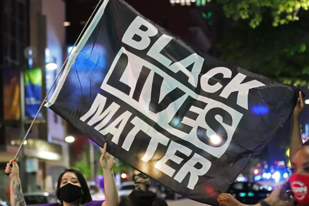 Photos: Dallas protest calls for justice following police shooting of Daunte Wright in Minnesota