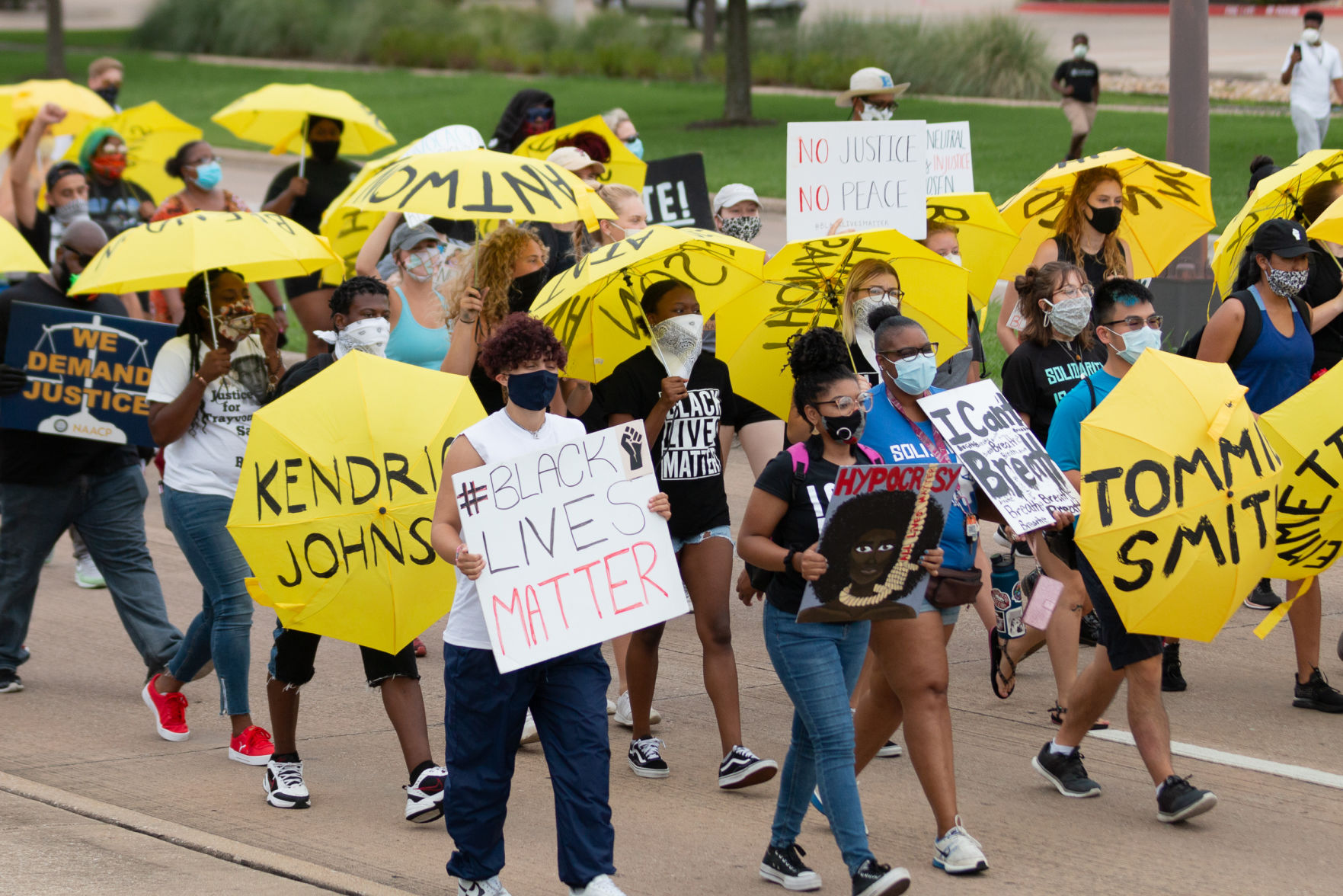 Arlington youth march with yellow umbrellas in remembrance of police brutality victims