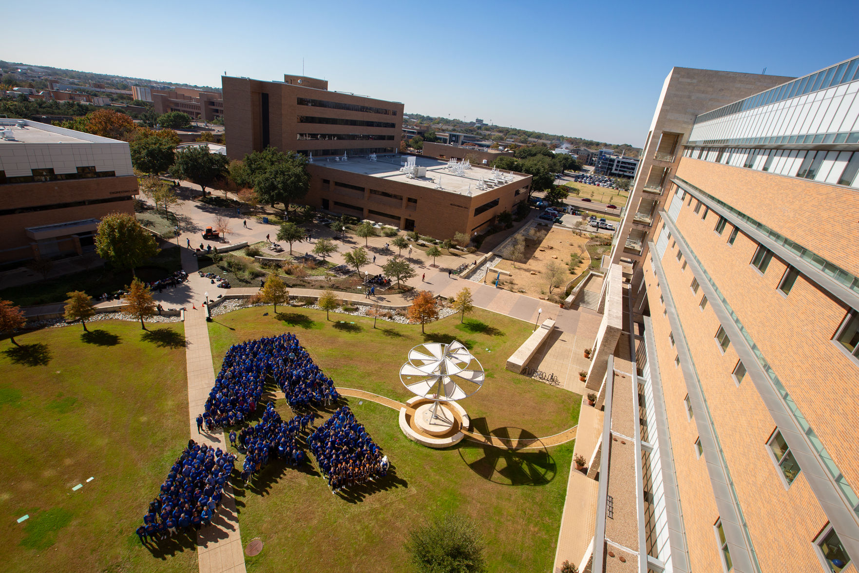 """Hundreds of students form the """"A"""" in UTA in an expression of school spirit"""