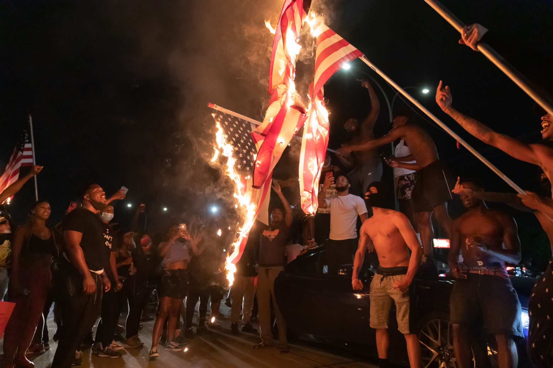 Photos: American flags set aflame in Arlington during protest against police brutality
