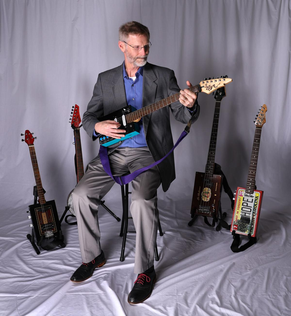 UTA professor builds, plays guitars crafted from cigar boxes in his spare time