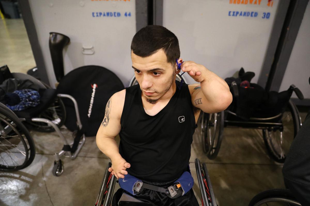 Photos: Movin' Mavs warm up for National Intercollegiate Wheelchair Basketball Tournament