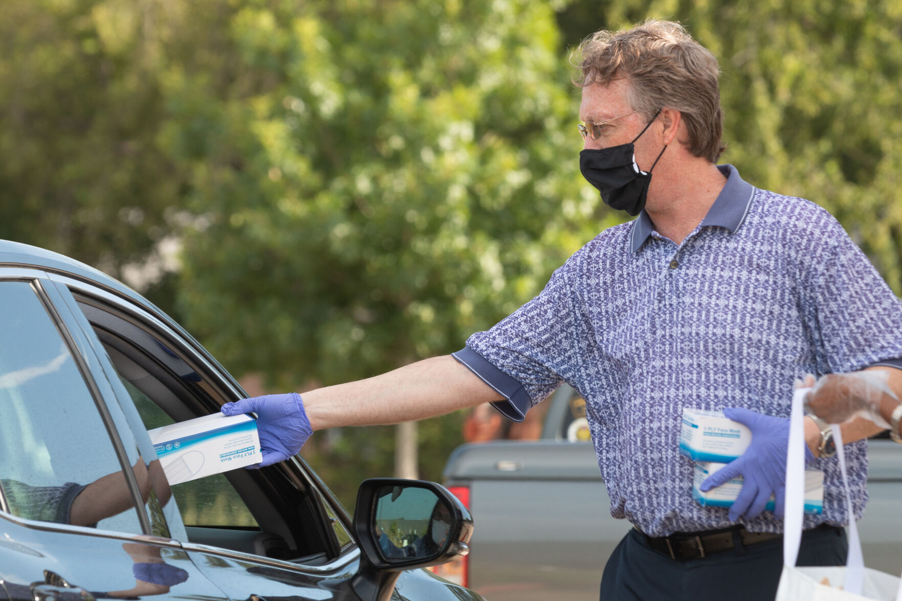 Photos: Cars line up for over three miles at Arlington face mask distribution
