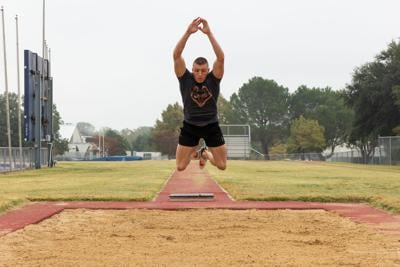 Junior track and field athlete sets Guinness World Record for highest standing jump