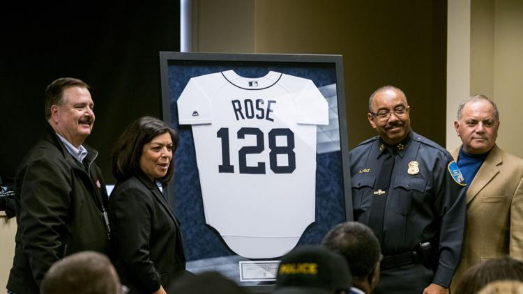 Tigers' General Manager Al Avila presents a commemorative jersey to the Wayne State Police Department in honor of Sgt. Collin Rose