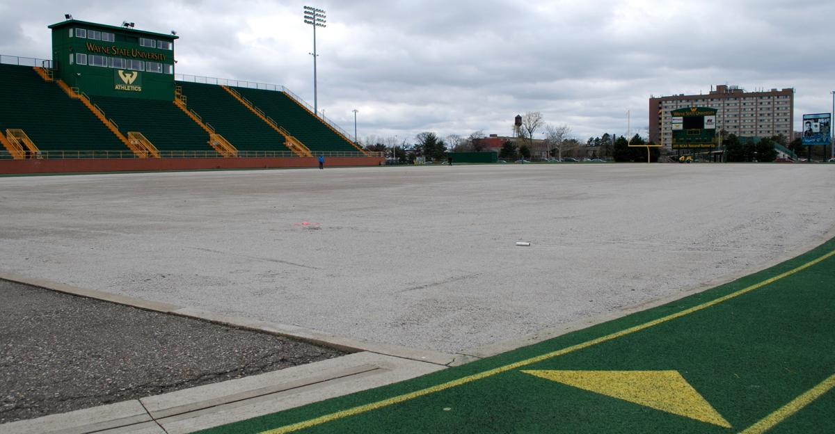 Tom Adams Field is naked on Monday, April 27 after workers stripped the field of its old synthetic turf ahead of replacement work.