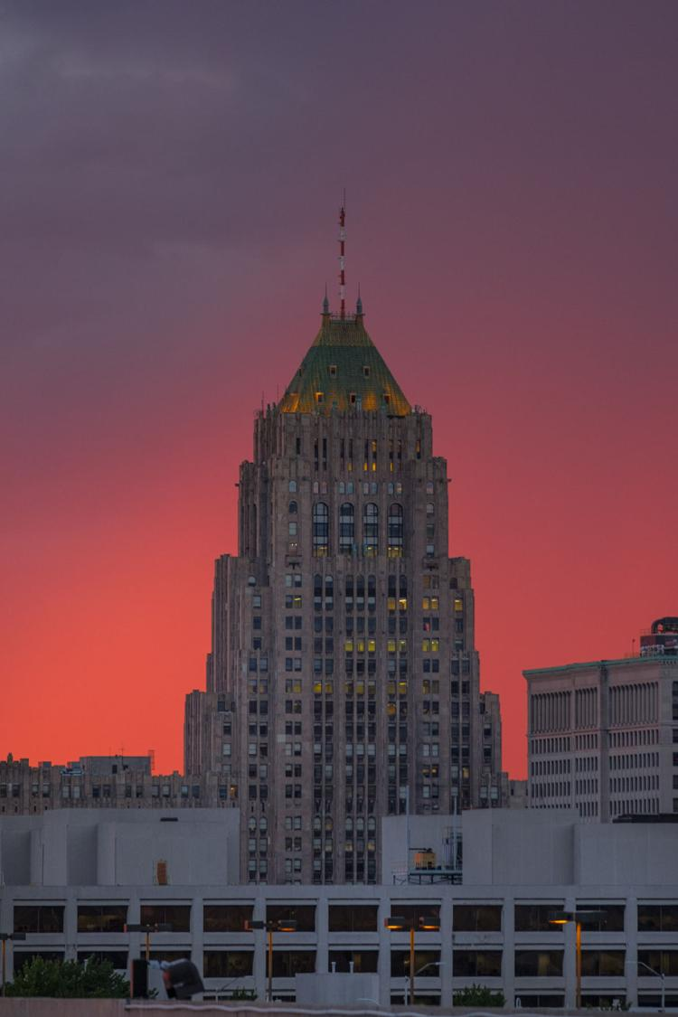 Rain showers passing to the north made the sky light up and create a cool background for the Fisher Building.