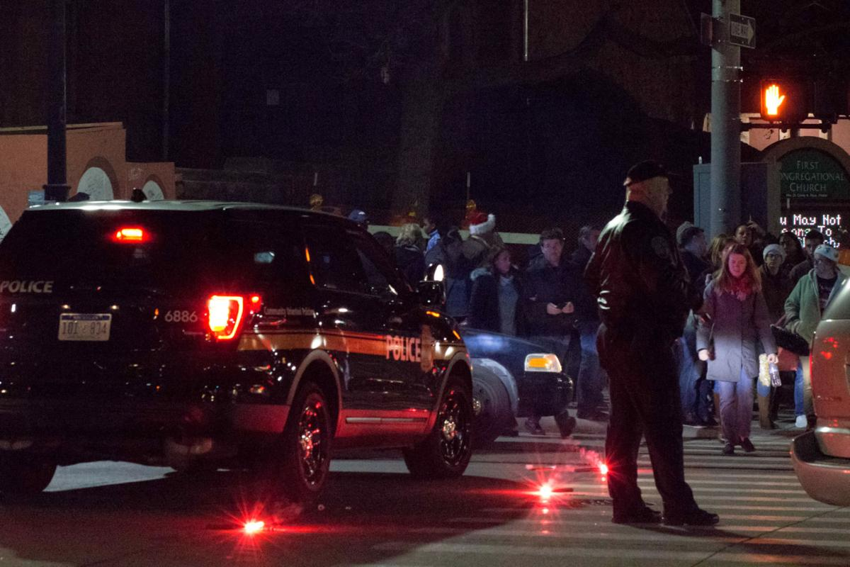 Police direct traffic out of midtown as Noel Night is forced to end early.