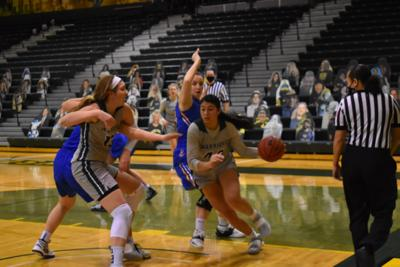 Women's basketball notches postseason victory in Matthaei Center finale