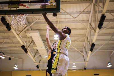 Men's basketball picks up first win, women struggle versus Ferris State