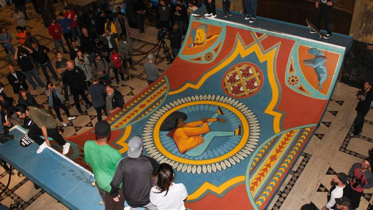 Skaters take turns showing off their skills on the Fisher Building's temporary halfpipe.