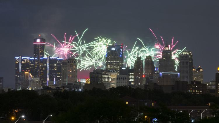 The annual Ford Fireworks started off dry, but rain showers quickly forced crowds to seek cover.