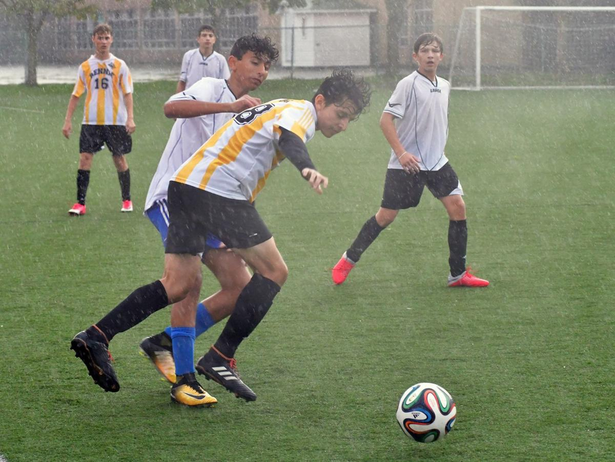 LCCHS upsets undefeated John Rennie in rain soaked game