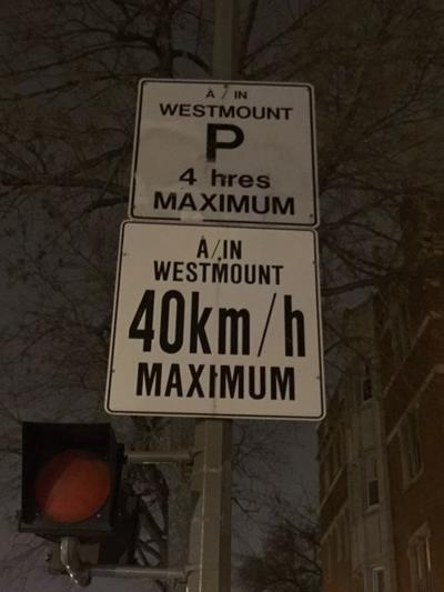 Parking signs must be French-only, Trent insists