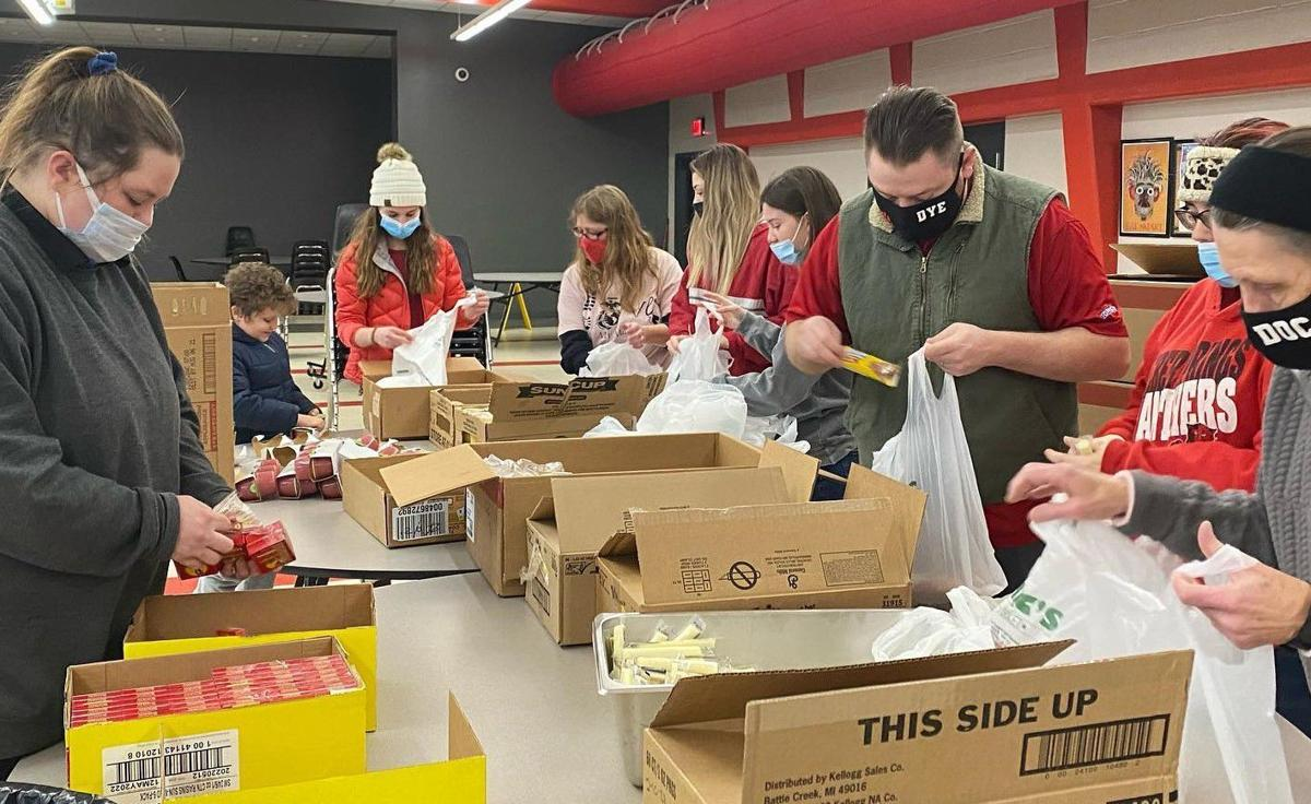 Panther pride packing up food boxes