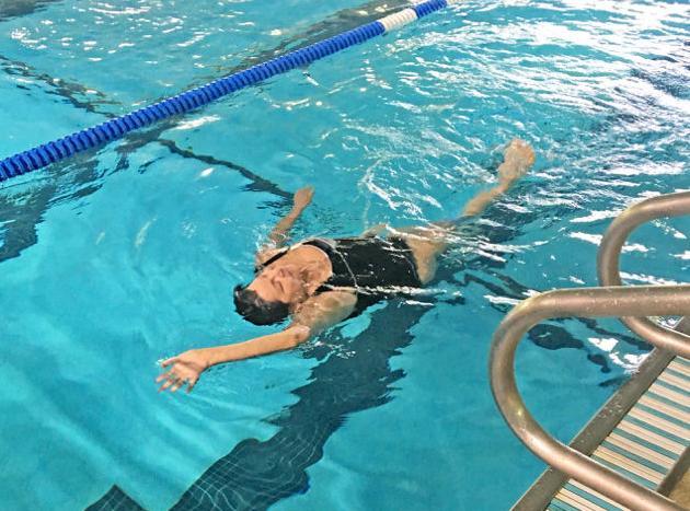 Mary Ferguson swims the back stroke