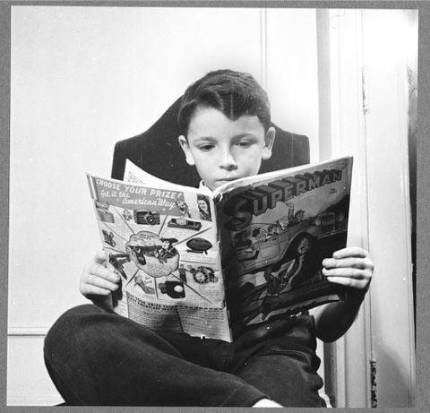 kid reading comiscs