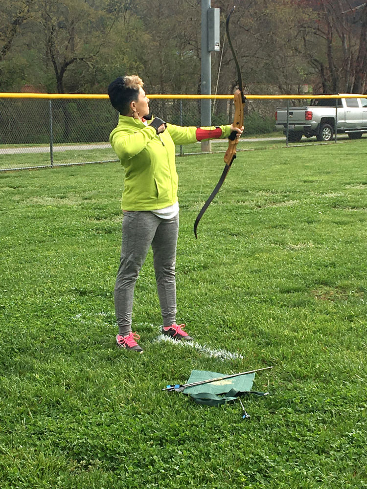 Pat Oocumma competes in archery