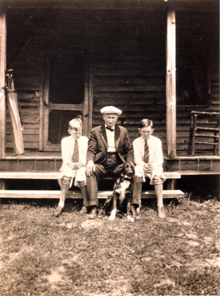 Sylva businessman E.L. McKee with his sons