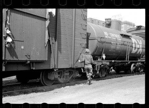Hobos jumping a train