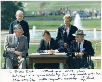 Bush signs the ADA