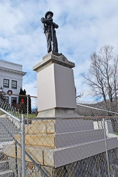 confederate monument base covered