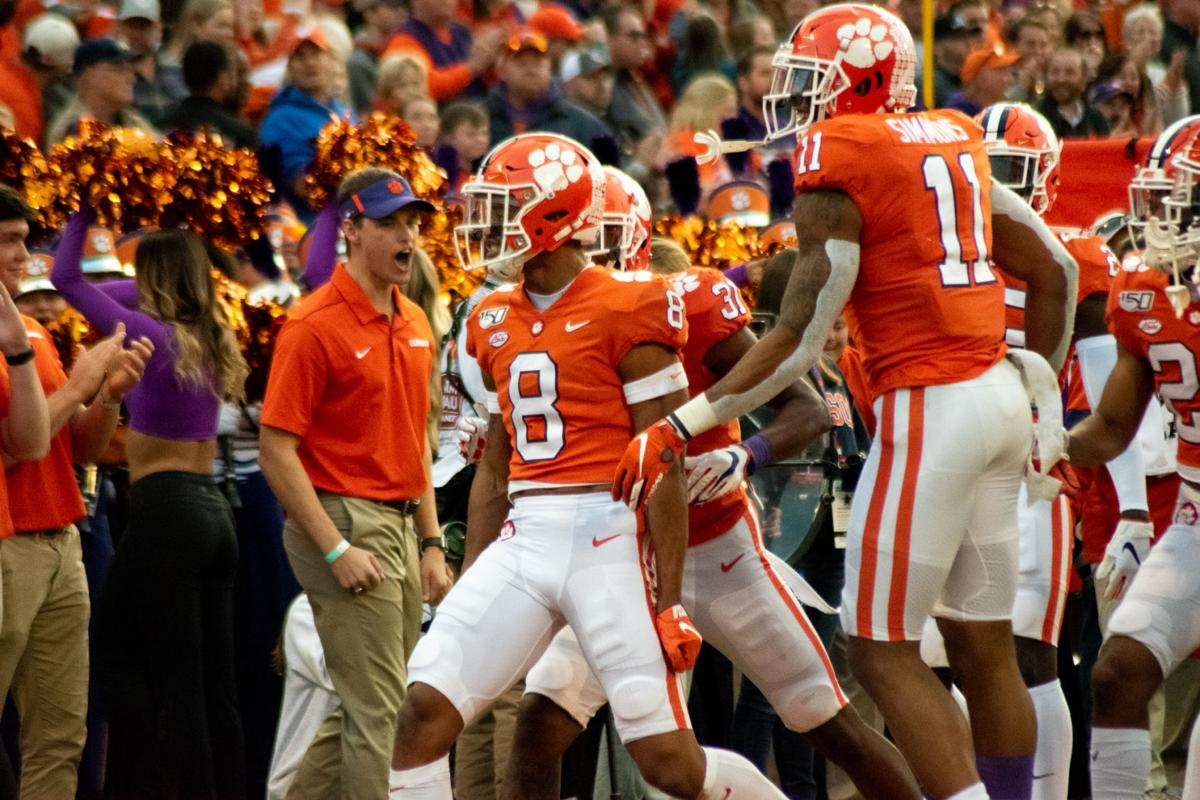 Lawrence, Higgins lead Tigers past Demon Deacons on Senior Day