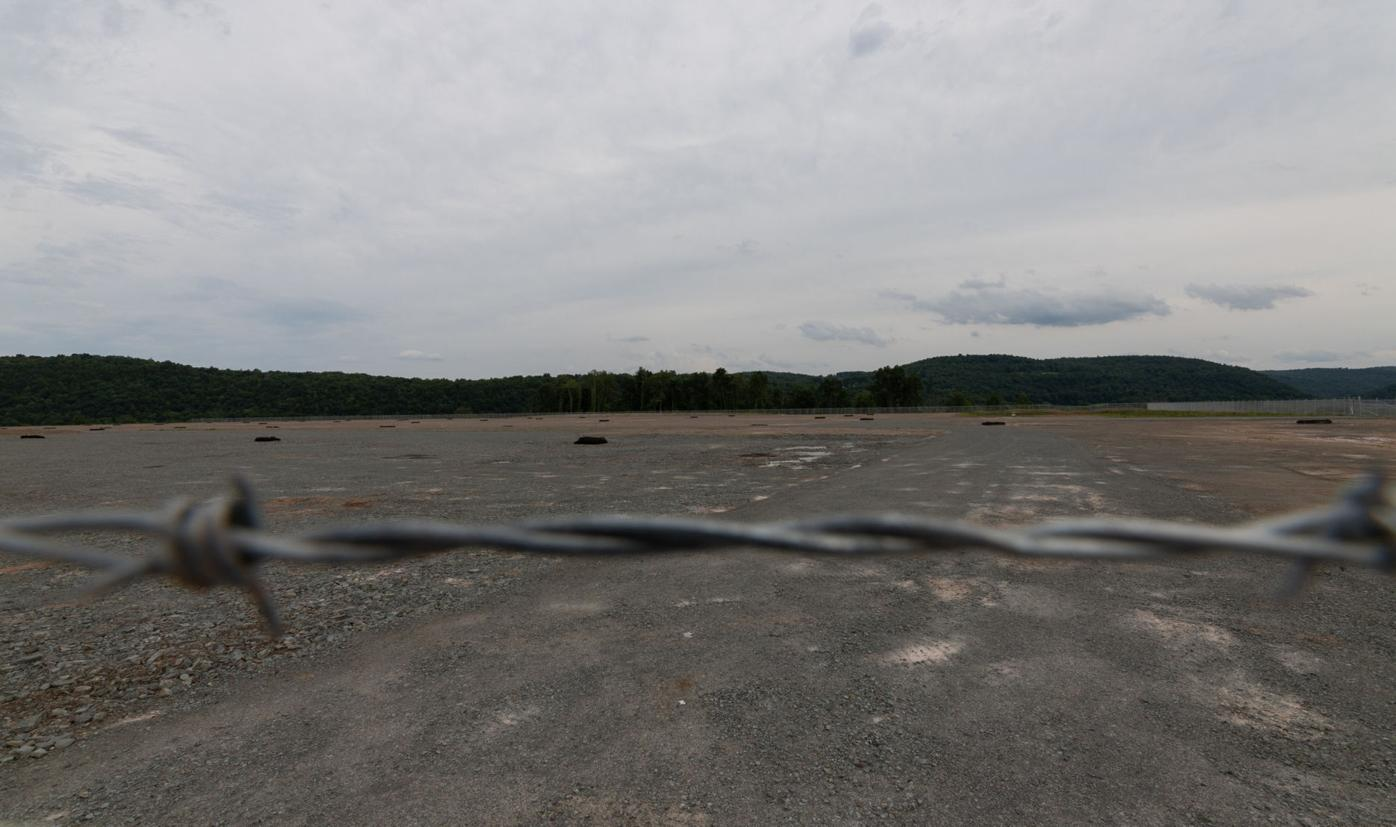 Barbed wire-topped fences surrounded the site of the New Fortress Energy liquefied natural gas plant on Thursday in Wyalusing Twp. Work at the site temporarily stopped in mid-June. Frank Wilkes Lesnefsky / Staff Photo