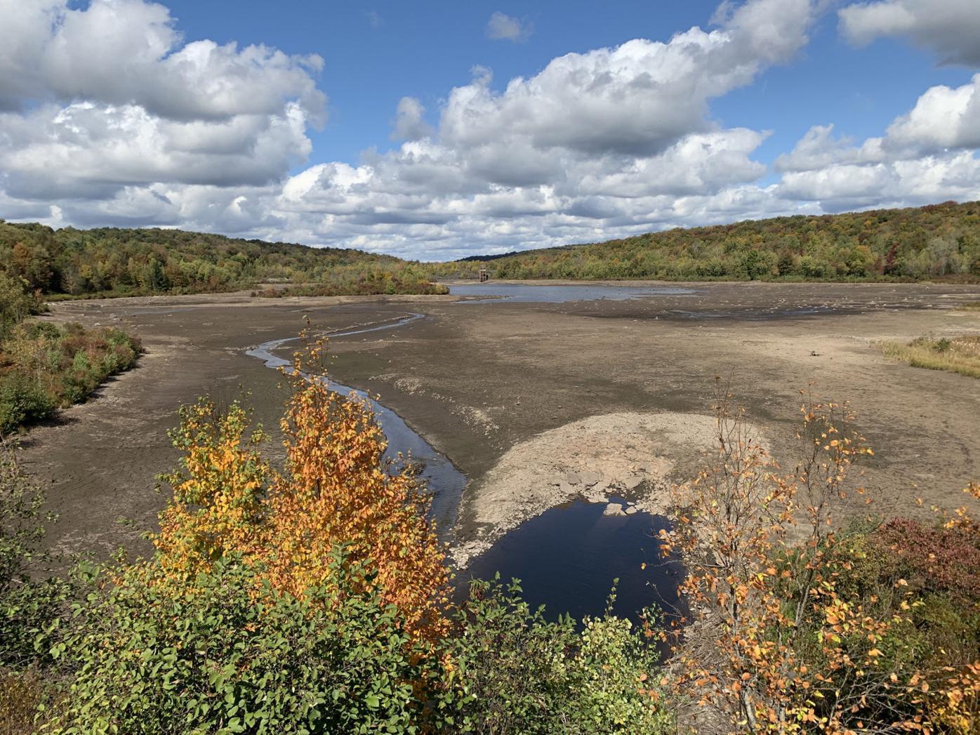 Draining of reservoir reveals submerged stolen pickup truck