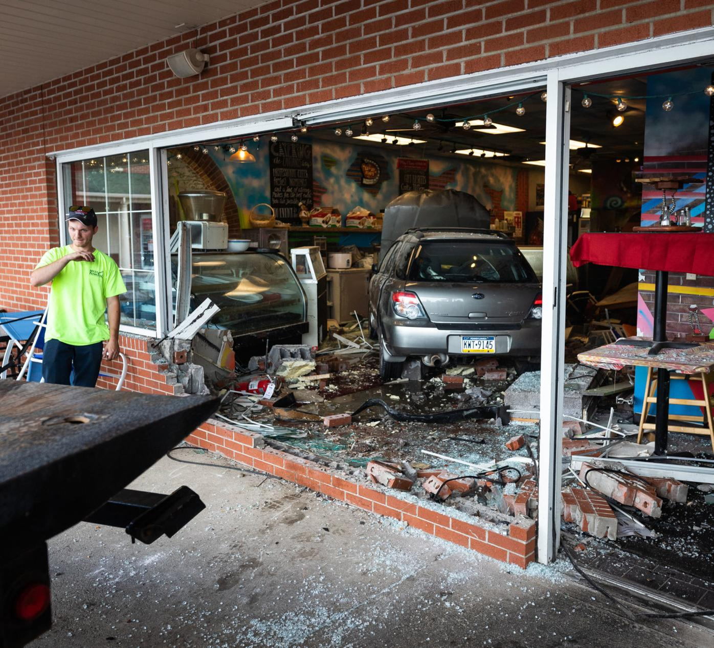 Crews prepare to remove a Subaru Outback from Cangiano's in the Fashion Mall plaza on the Scranton-Carbondale Highway in Dickson City on Monday. Frank Wilkes Lesnefsky / Staff Photo