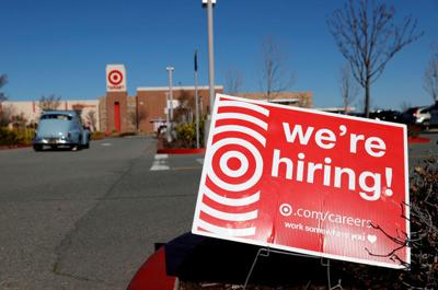 A hiring sign is posted in front of a Target store on February 5, 2021 in San Rafael, California.