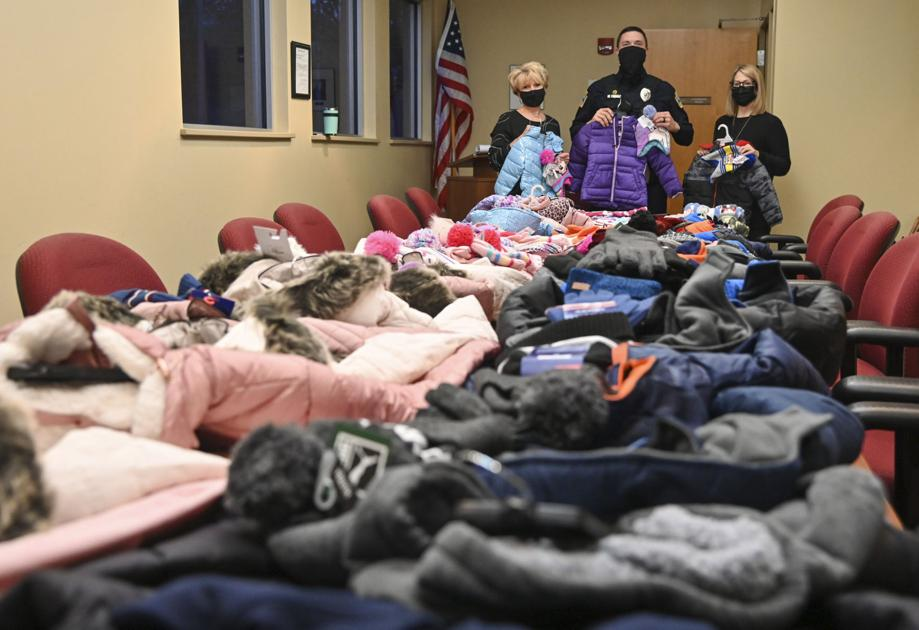 Though trimmed by COVID-19, city police department's annual coat drive continues