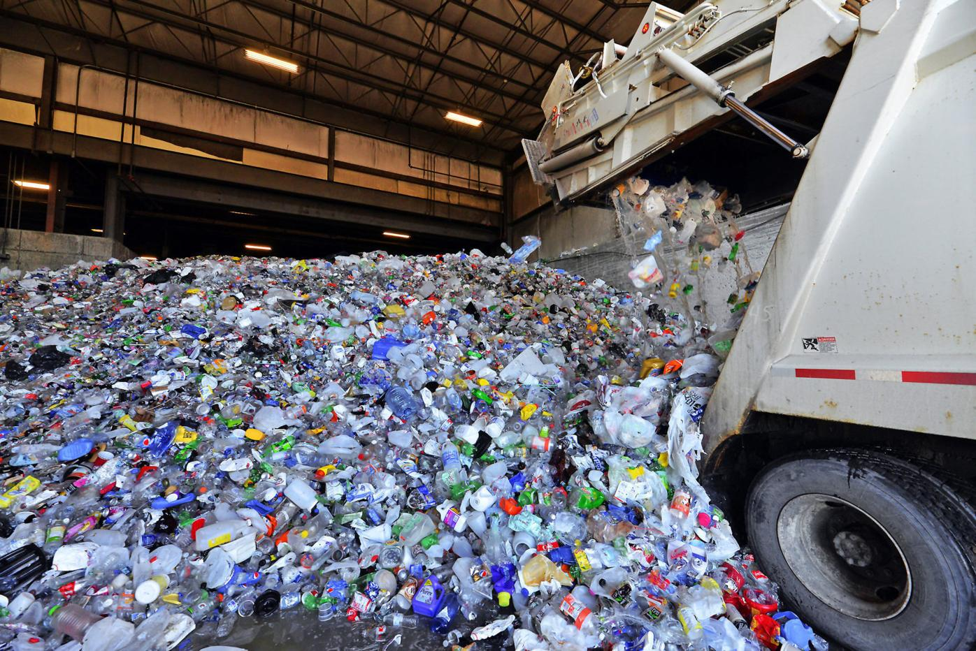 Recycling center operator to charge municipalities for bottles, cans and jars
