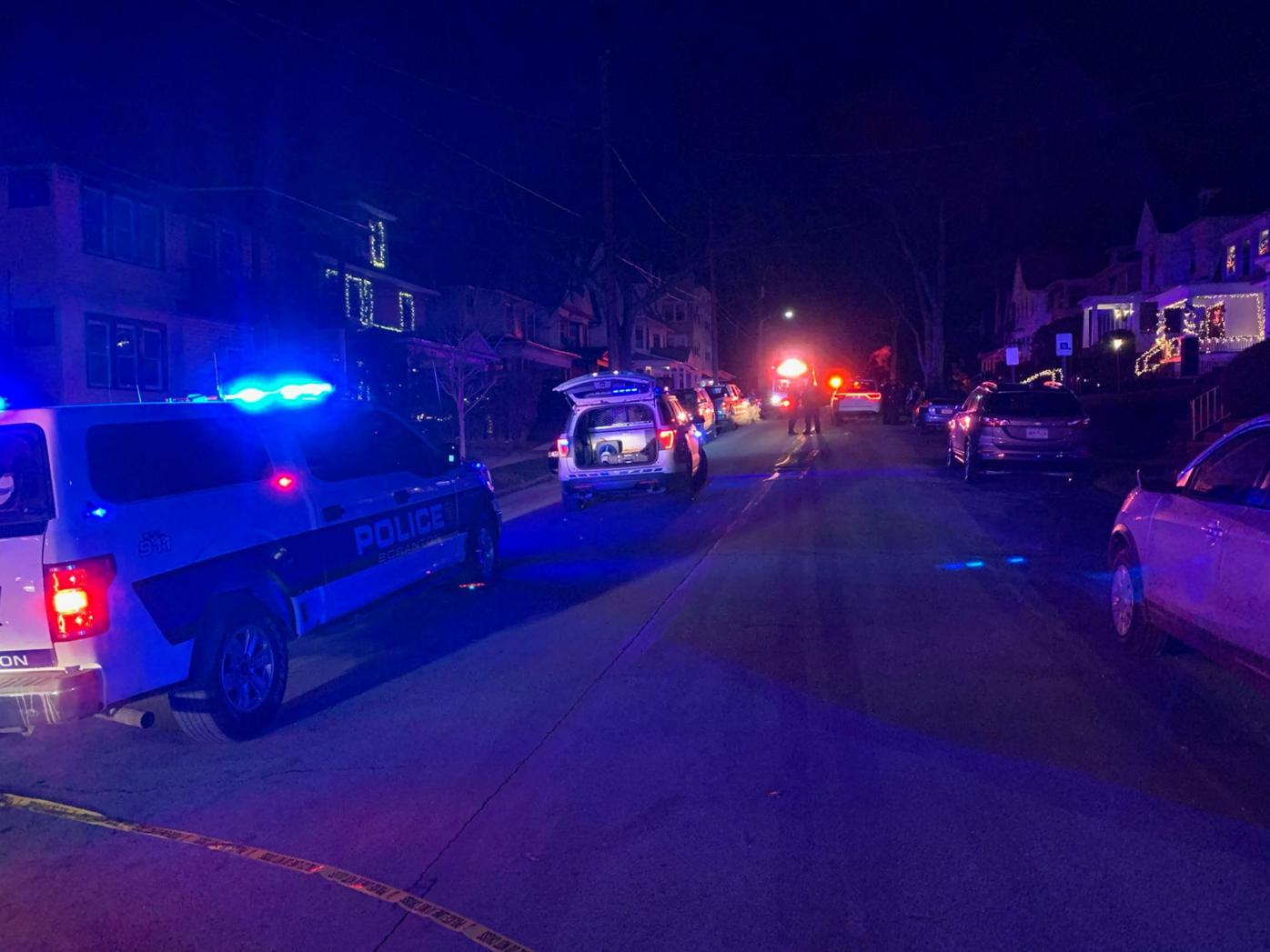 Police are on the scene of a reported shooting Tuesday night in the 400 block of Wheeler Avenue. JIM LOCKWOOD/STAFF PHOTO