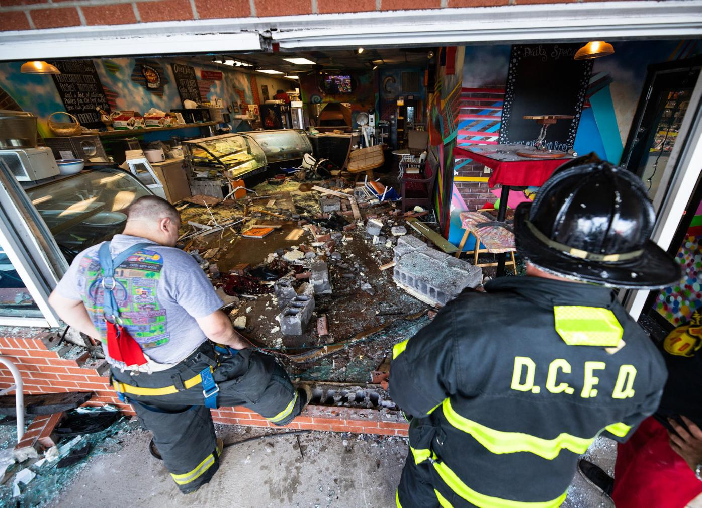 Dickson City firefighters assess the damage at Cangiano's on the Scranton-Carbondale Highway after a Subaru Outback smashed through the pizza parlor's storefront on Monday. Frank Wilkes Lesnefsky / Staff Photo