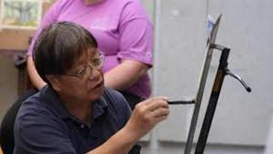 Professional watercolorist shares his art with students